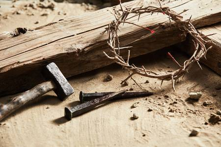 96322722-easter-background-depicting-the-crucifixion-with-a-rustic-wooden-cross-hammer-nails-and-crown-of-tho.jpg